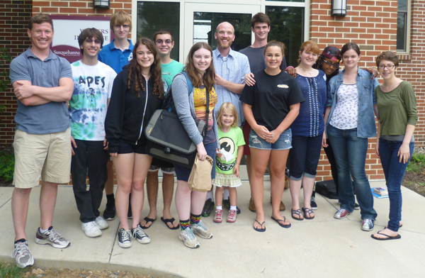 Left to right: Bobby Mitchell, Christopher Lombardo, Nate Adler, Amelia Channin, Travis Bederka, Allison, Silas Dent-Zobal (and his daughter, Lake), Tom Leggett, Grace Dunnigan, Hannah Davis, Faith Thompson, Catherine Baker, and Mallory Steffey. Taken outside the Writers' Institute.